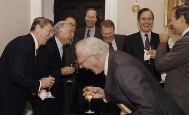 Men in suits laughing at a party