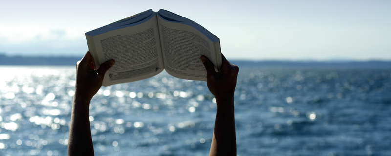 An open book by the ocean