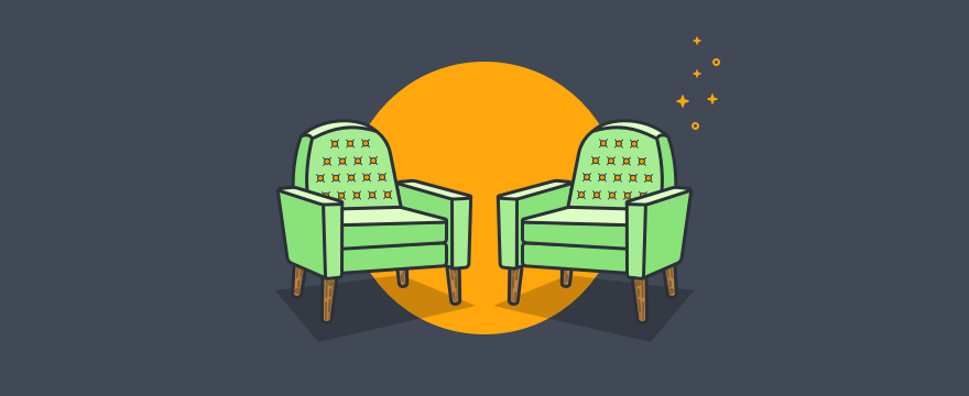 Two chairs next to one another.