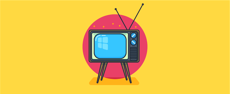 Vintage television set on yellow background.