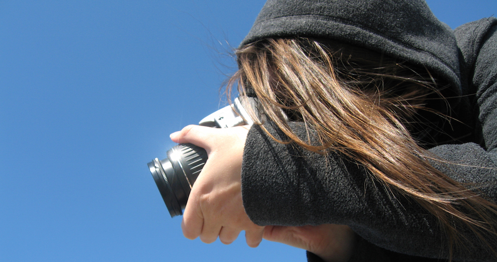 A woman with a large camera