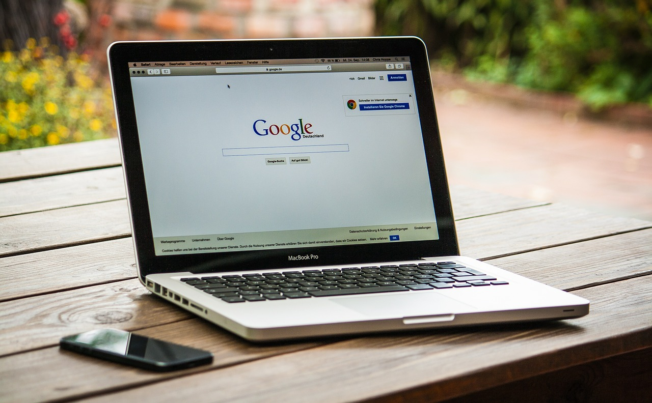 laptop opened to google homepage