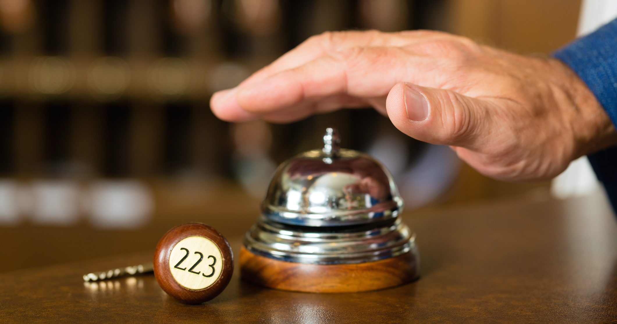A hand over a bell